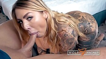 Attractive babe blows tattooed penis and gets fucked on top