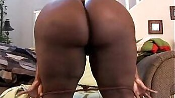 Busty black babe cums on her fat pussy