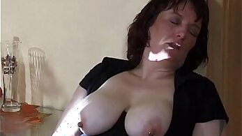 Yummy mommy with buttplug and tongue masturbates to squirt